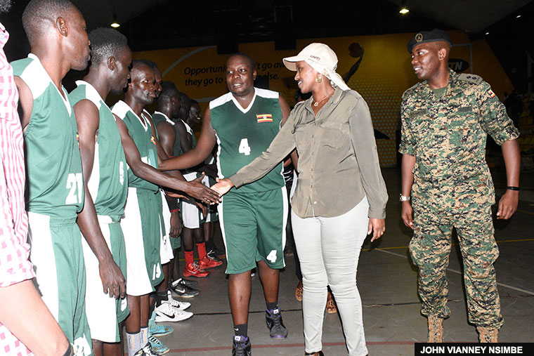 Natasha Museveni inspects the UPDF Tomahawks basketball team recently before a league match. She was recently appointed President of the club