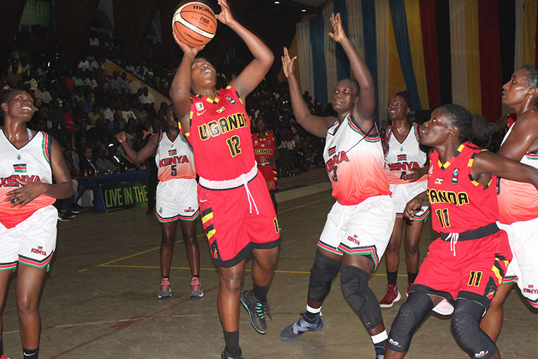 Uganda's Hope Akello beats Kenya's Vilma Achieng, to go for the hoop