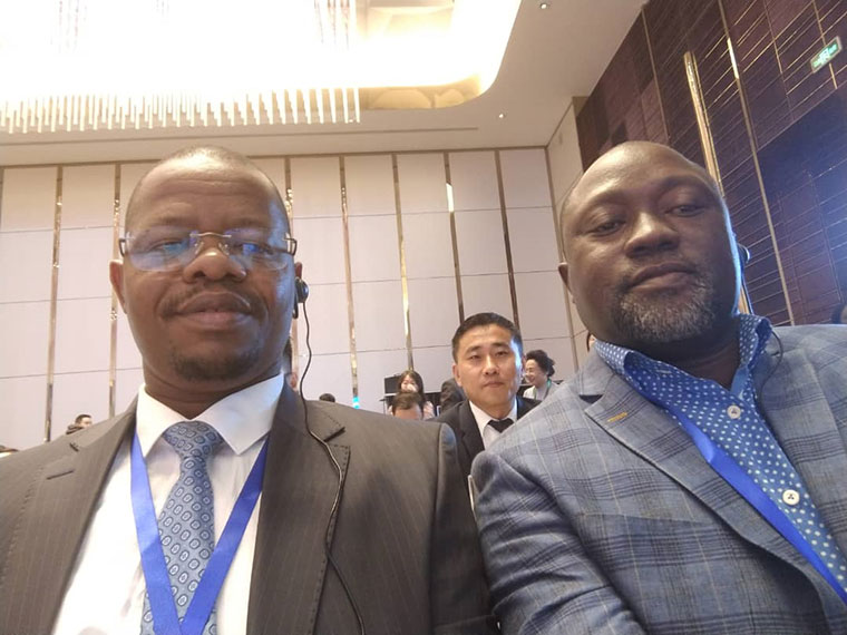 Fufa boss Moses Magogo (L) and Ben Misagga after sealing the sponsorship deal in Beijing, China earlier this year