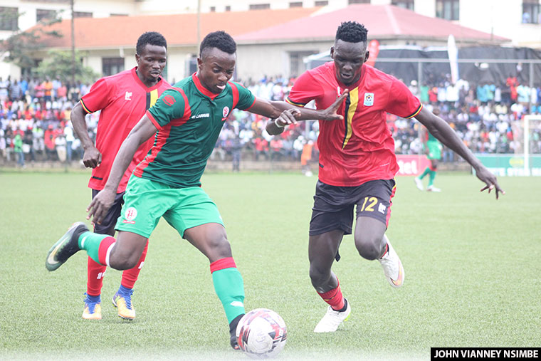 Cranes defender Mustafa Kizza tries to stop a Burundi attacker during the Chan qualifiers
