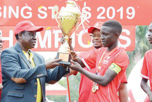 Eastern team captain, Phillip Egesa receives the trophy