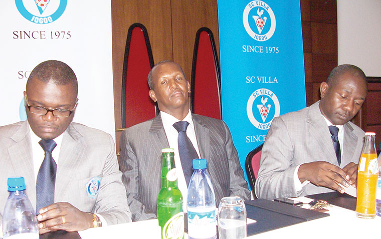 L-R: Fred Muwema, Ahmed Omar Mandela and William Nkemba on July 27, 2010 during the unveiling of  the SC Villa Limited board. Muwema was the head of that board