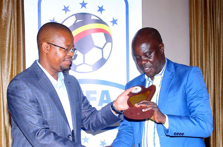 Fufa president Moses Magogo (L) with Rogers Mulindwa