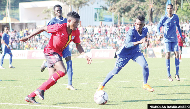 Uganda Cranes' Allan Okello (L) in action during a previous qualifying match