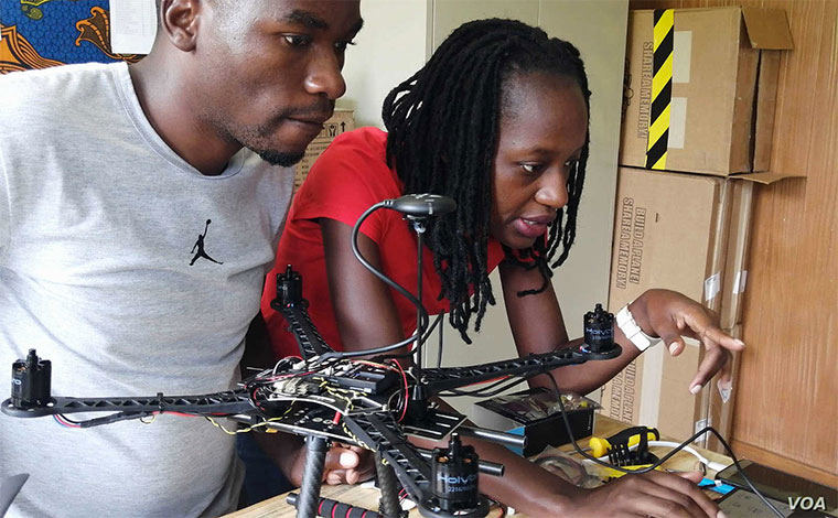 Karen Asaba (right) from Uganda is one of the 26 students at the African Drone and Data Academy in Malawi