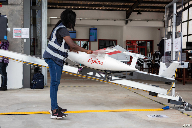 FILE - A staff member prepares a drone for the delivery of medical supplies at a service base run by operator Zipline, in Omenako, 70 kilometers north of Accra, Ghana