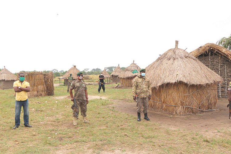 Some of the rangers outside their semi-permanent structures
