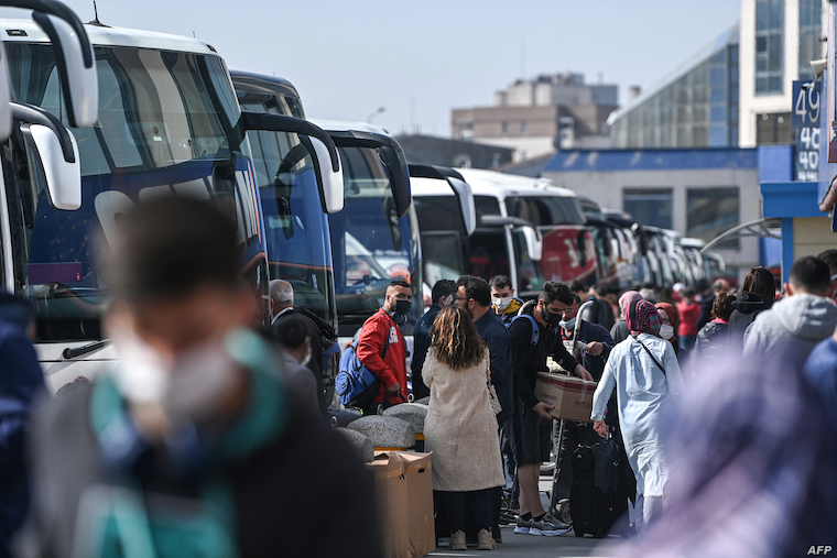 Travellers prepare to board buses in Instabul