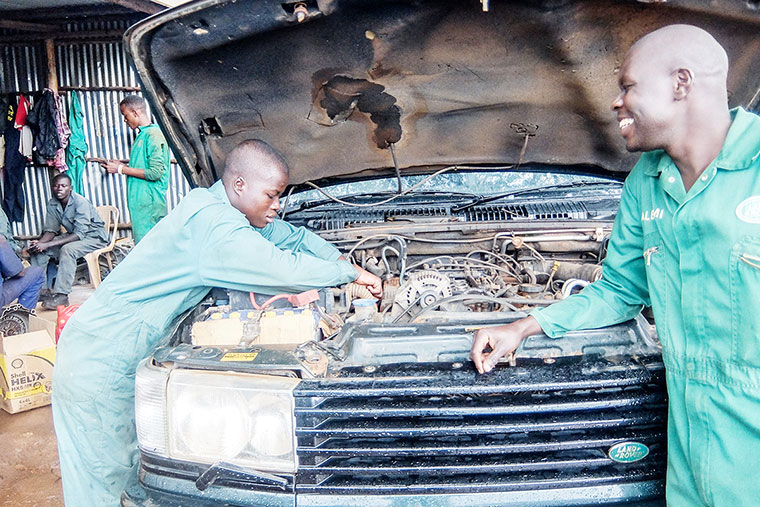 Mechanics working on a car. The draft automotive industry policy will put old-fashioned mechanics out of jobs