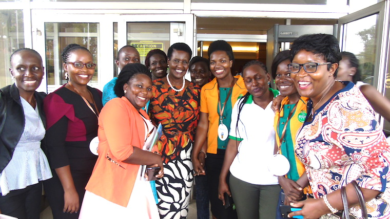 Minister Amelia Kyambadde poses for a photo with some of the participants